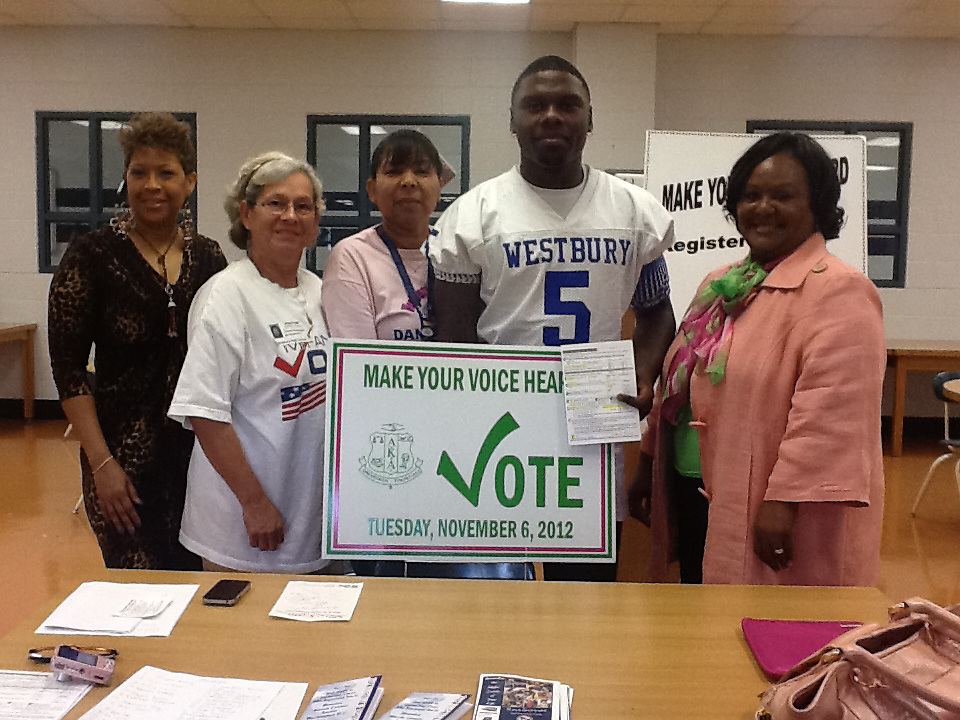 Westbury High School football star Nichorian Mardis registers to vote on Friday, Oct. 5, 2012.