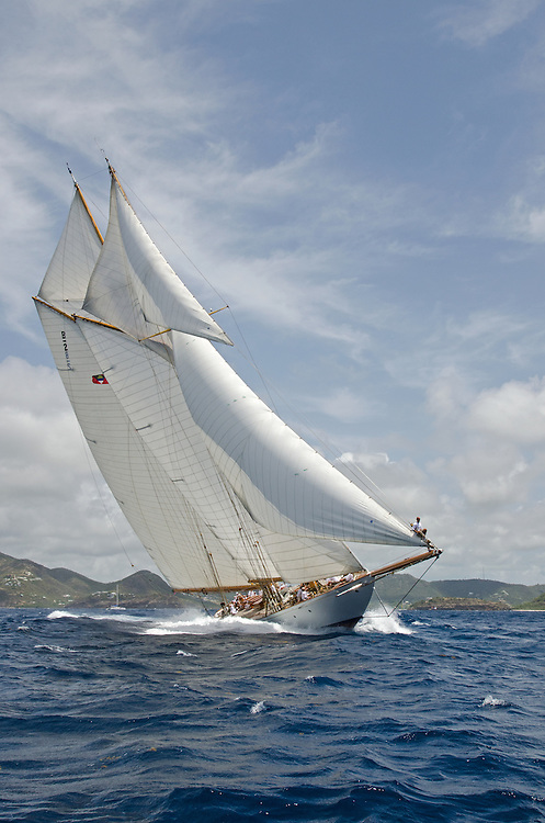 ELENA.<br /> <br /> Back in the 60s, classic yachts, which were gathered in English Harbour Antigua, had begun chartering and the captains and crews challenged each other to a race down to Guadeloupe and back to celebrate the end of the charter season. From this informal race, Antigua Race Week was formalised in 1967, and in those days all of the yachts were classics. As the years grew on, the classic yachts were slowly outnumbered but the faster sleeker modern racing yachts and 24 years later the Classic Class had diminished to a few boats and was abandoned in 1987. However this same year seven classic yachts turned out and were placed in Cruising Class 3 with the bare boats. The class was so unmatched that it was downright dangerous, so Captain Uli Pruesse hosted a meeting onboard Aschanti of Saba with several classic skippers and in 1988 the Antigua Classic Yacht Regatta was born, with seven boats.<br /> <br /> In 1991, Elizabeth Meyer brought her newly refitted Endeavour and Baron Edmond Rothschild brought his 6-meter Spirit of St Kitts and &ldquo;CSR&rdquo; became the first Sponsor and inaugurated the Concours d&rsquo;El&eacute;gance. In 1996 we created the &ldquo;Spirit of Tradition Class&rdquo;, which has now been accepted all over the world, which gives the &ldquo;new&rdquo; classics, built along the lines of the old, a chance to sail alongside their sister ships. In 1999 we celebrated the first race between the J class yachts in 60 years. Mount Gay Rum has sponsored the Regatta for many years, and we have recently added Officine Panerai as our first ever Platinum Sponsor.<br /> <br /> The Antigua Classic Yacht Regatta has maintained a steady growth, hosting between 50 and 60 yachts every year and enjoys a wonderful variety of competitors, including traditional craft from the islands, classic ketches, sloops, schooners and yawls making the bulk of the fleet, together with the stunningly beautiful Spirit of Tradition yachts, J Class yachts and Tall Ships.