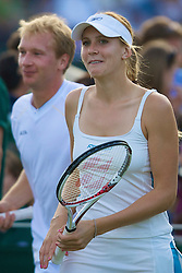 LONDON, ENGLAND - Saturday, June 28, 2008: Czech beauty Nicole Vaidisova (CZE) and Lukas Dlouhy (CZE) during their mixed doubles second round match on day six of the Wimbledon Lawn Tennis Championships at the All England Lawn Tennis and Croquet Club. (Photo by David Rawcliffe/Propaganda)
