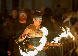 Members from fire group Pyroceltica kicked off Edinburgh's Hogmanay celebration's by leading off the annual torchlight procession down the Royal Mile.<br /> <br /> &copy; Dave Johnston / EEm
