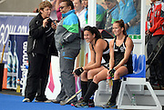 Kayla Whitelock and Petrea Webster on the sideline after Whitelock was sent off for having too many players on the pitch during a Black Sticks Women v England Semi Final match at the Glasgow National Hockey Stadium. Glasgow Commonwealth Games 2014. Friday 1 August 2014. Scotland. Photo: Andrew Cornaga/www.Photosport.co.nz