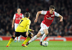 23.11.2011, Emirates Stadion, London, ENG, UEFA CL, Gruppe F, FC Arsenal (ENG) vs Borussia Dortmund (GER), im Bild Arsenal's Aaron Ramsey in action against Borussia Dortmund's Moritz Leitner during the football match of UEFA Champions league, group F, between FC Arsenal (ENG) and Borussia Dortmund (POR) at Emirates Stadium, London, United Kingdom on 2011/11/23. EXPA Pictures © 2011, PhotoCredit: EXPA/ Sportida/ Chris Brunskill..***** ATTENTION - OUT OF ENG, GBR, UK *****