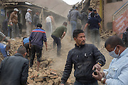 Devastating April 2015 Nepal Earthquake. Bungamati, Kathmandu Valley, shortly after the earthquake struck. Digging through the rubble of a fallen brick house, searching for people trapped inside.