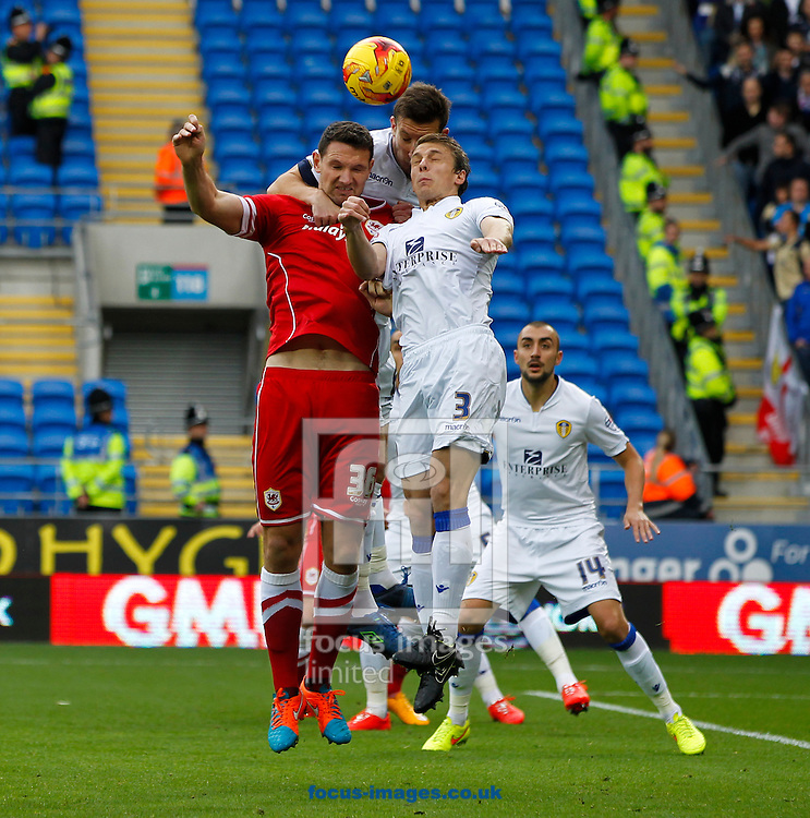 Sean Morrison of Cardiff City and Stephen Warnock of Leeds United during the Sky Bet Championship match at the Cardiff City Stadium, Cardiff<br /> Picture by Mike  Griffiths/Focus Images Ltd +44 7766 223933<br /> 01/11/2014