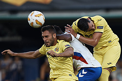 September 20, 2018 - Vila-Real, Castellon, Spain - Victor Ruiz (L) of Villarreal CF heads the ball next to Lassana Coulibaly (C) of Rangers and his teammate Funes Mori during the UEFA Europa League group G match between Villarreal CF and Rangers at Estadio de la Ceramica on September 20, 2018 in Vila-real, Spain  (Credit Image: © David Aliaga/NurPhoto/ZUMA Press)
