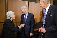 Barbara Grassley (from left), wife of Sen. Grassley, shakes hands with Neil Gorsuch as Sen. Chuck Grassley looks on during a break in the second day of hearings before the Senate Judiciary Committee for Neil Gorsuch to become an Associate Justice of the US Supreme Court in the Hart Senate Office Building in Washington, D.C. on Tuesday, Mar. 21, 2017.