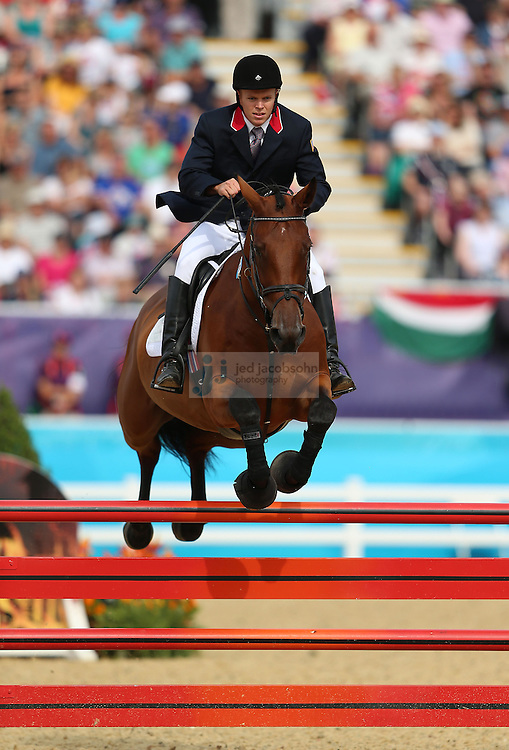 Dennis Bowsher of the USA competes during the riding portion of the men's modern pentathlon during day 15 of the London Olympic Games in London, England, United Kingdom on August 11, 2012..(Jed Jacobsohn/for The New York Times)..