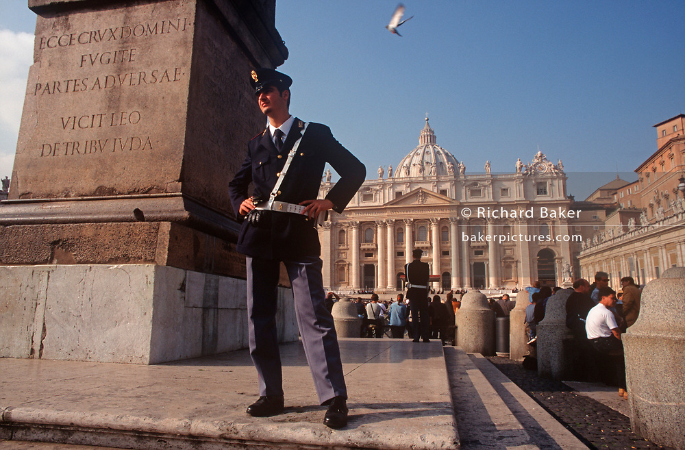 Two police officers keep watch over tourists in the centre of St. Peter's Square in the Vatican, on 3rd November 1999, in Rome Italy. (Photo by Richard Baker / In Pictures via Getty Images)