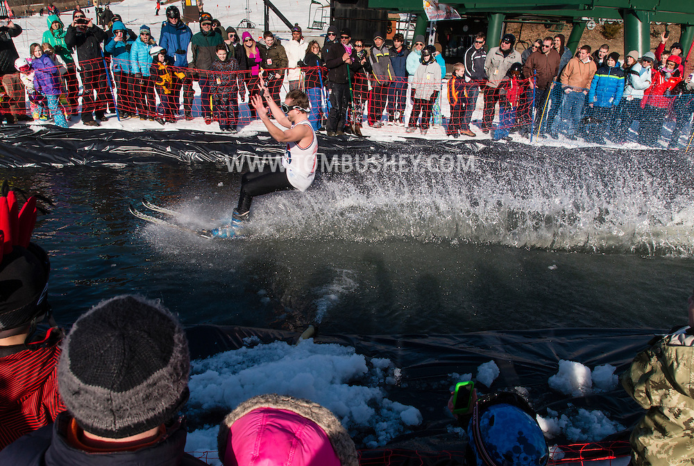 A skier wearing a tank-top crosses the water during the Wacky Water Event at the Spring  Rally at Mount Peter Ski and Ride in Warwick, New York. The Spring Rally traditionally closes the season at the ski area.