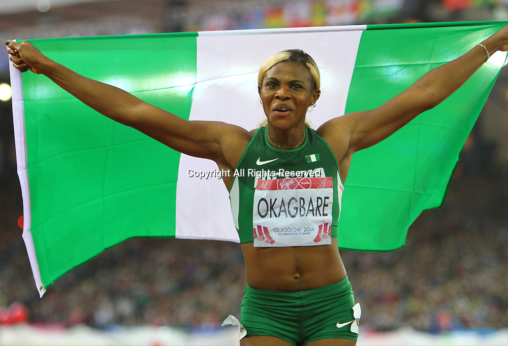 31.07.2014. Glasgow, Scotland. Glasgow Commonwealth Games. Women's 200m final from Hampden Park. Blessing Okagbare wins gold and celebrates with the Nigerian flag