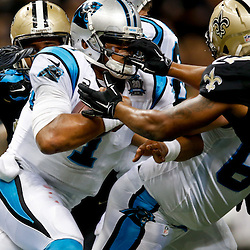 Dec 7, 2014; New Orleans, LA, USA; Carolina Panthers quarterback Cam Newton (1) is tackled by New Orleans Saints inside linebacker David Hawthorne (57) and defensive end Cameron Jordan (94) during the first half of a game at the Mercedes-Benz Superdome. Mandatory Credit: Derick E. Hingle-USA TODAY Sports