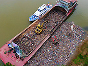 WUZHOU, CHINA - SEPTEMBER 04: <br /> <br /> Aerial view of the Xun River partly covered by the waste illegally poured from the garbage ship at Teng County on September 4, 2016 in Wuzhou, Guangxi Zhuang Autonomous Region of China. A ship from Guangdong Dongguan transferred about 400 tons of household garbage to Guangxi Teng County (or Tengxian), and poured the waste into the Xun River at the night of September 3. About 100 tons of waste has been poured into the river, and staff from county\'s Marine Affairs Bureau, Environmental Protection Bureau, Public Security Bureau, Water Conservancy Bureau and other departments concerned conducted an investigation of the case. <br /> ©Exclusivepix Media