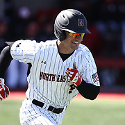 Connor Lyons #5 of the Northeastern Huskies runs to first base during the game at Friedman Diamond on March 16, 2014 in Brookline, Massachusetts. (Photo by Elan Kawesch)