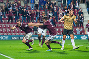 Craig Halkett (#26) of Heart of Midlothian FC rns to celebrate after he scores the equalising goal in injury time during the Betfred Scottish Football League Cup quarter final match between Heart of Midlothian FC and Aberdeen FC at Tynecastle Stadium, Edinburgh, Scotland on 25 September 2019.