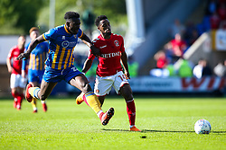 Tariqe Fosu of Charlton Athletic takes on Aristote Nsiala of Shrewsbury Town - Mandatory by-line: Robbie Stephenson/JMP - 13/05/2018 - FOOTBALL - Montgomery Waters Meadow - Shrewsbury, England - Shrewsbury Town v Charlton Athletic - Sky Bet League One Play-Off Semi Final