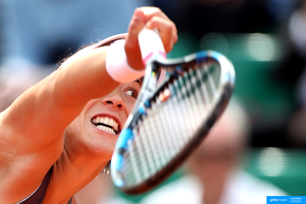 2017 French Open Tennis Tournament - Day Eight.  Garbine Muguruza of Spain in action against Kristina Mladenovic of France in the Women's Singles round four match in front of a full house on Suzanne-Lenglen Court at the 2017 French Open Tennis Tournament at Roland Garros on June 4th, 2017 in Paris, France.  (Photo by Tim Clayton/Corbis via Getty Images)