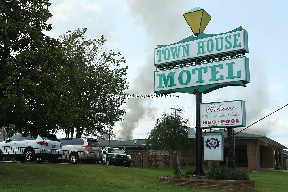 Smoke arises from the roof of the Town House Motel on South Gloster Street in Tupelo as firefighters work to put out the blaze on Wednesday afternoon.