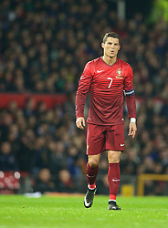 MANCHESTER, ENGLAND - Tuesday, November 18, 2014: Portugal's captain Cristiano Ronaldo feels an injury during the International Friendly match against Argentina at Old Trafford. (Pic by David Rawcliffe/Propaganda)