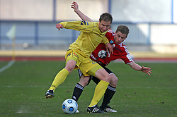 Dzengis Cavusevic of Domzale vs Nejc Skubic of Interblock at 24th round of  Slovenian football first league PrvaLiga Telekom Slovenije match between NK Domzale and NK Interblock, on March 14, 2009, in Domzale, Slovenia. (Photo by Vid Ponikvar / Sportida)