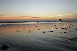 Surfer on Kuta Beach at sunset, Bali, Indonesia, Southeast Asia