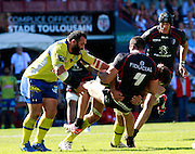 Yoann Maestri is tackled by Julien Pierre and Davit Zirakashvili of ASM. Stade Toulousain v ASM Clermont Auvergne, Stade Ernest Wallon, Samedi 13 September 2014. Top 14 5eme Journee.