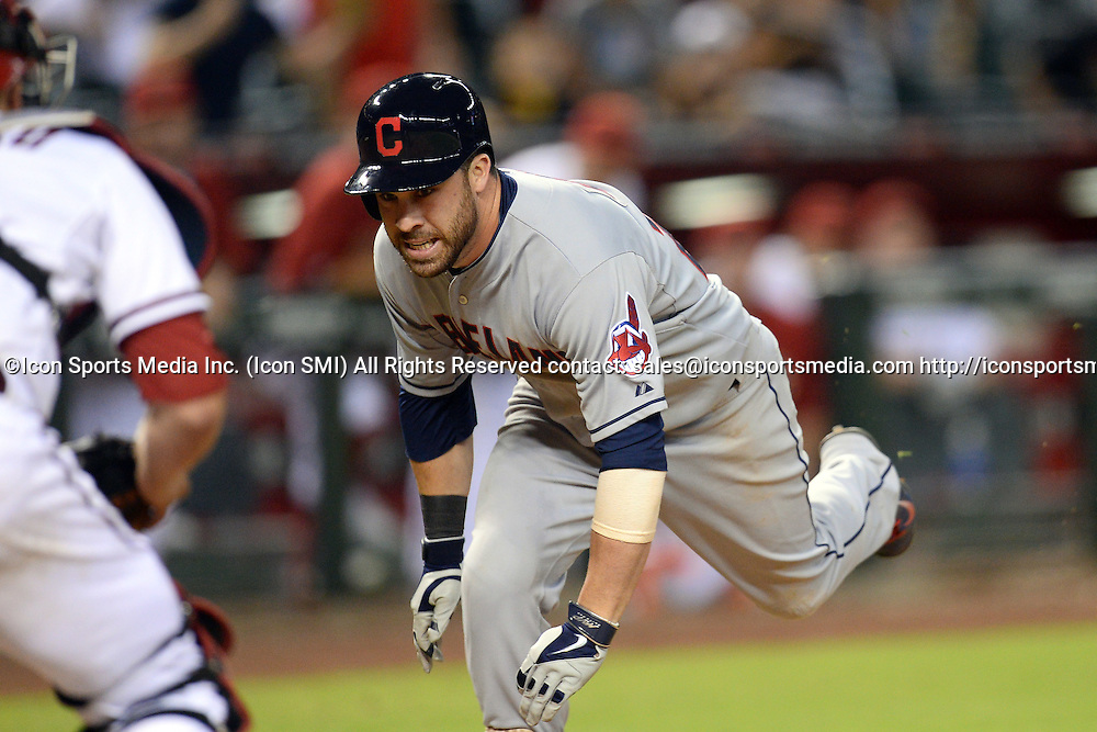 Jun 24, 2014; Cleveland Indians second baseman Jason Kipnis (22) attempts to score an in-the-park home run in the 13th inning against the Cleveland Indians at Chase Field. The Diamondbacks won 9-8 in 14 innings.
