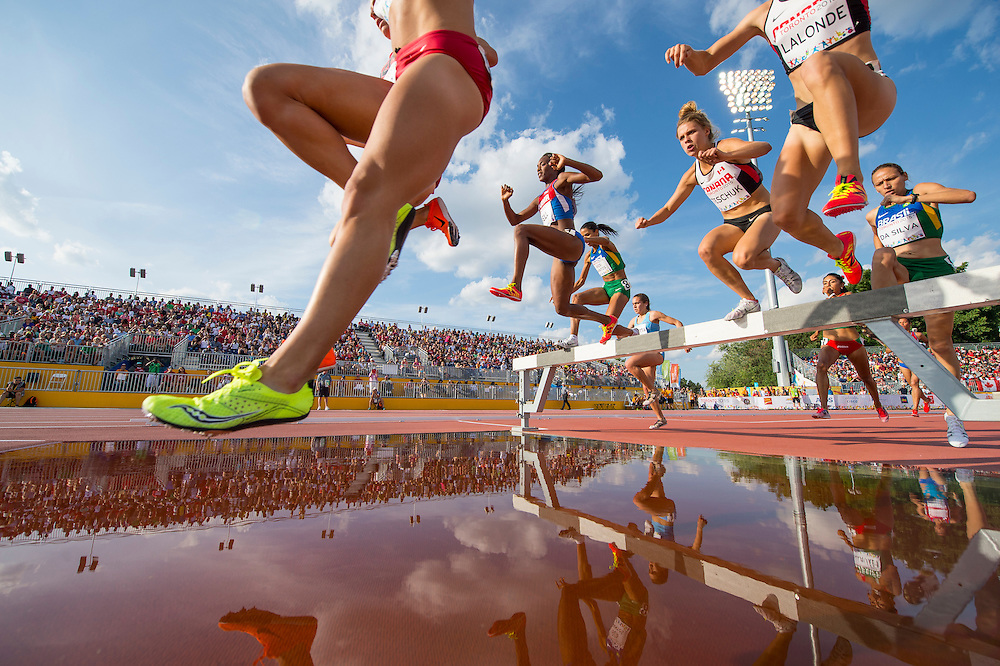 Women's 300 meter Steeplechase- Runners cross the water jump during athletics competition at the 2015 PanAm Games in Toronto.
