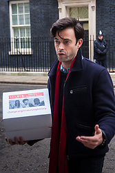 "Downing Street, London, January 7th 2015. TV star 2015-01-07 TV star Jolyon Rubinstein delivers a ""Make Lying in Parliament History"" petition with 111,913 signatures to 10 Downing Street. The petition aims ""to start a debate about the importance of the truth in politics"" and comes off the back of his satirical TV show The Revolution Will be Televised which has been "" highlighting the corruption, greed and hypocrisy in our system"" and wants to make lying in Parliament a criminal offence. PICTURED: Jolyon Rubinstein outside 10 Downing Street."
