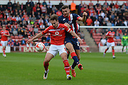 Tom Bradshaw holds the ball from Aaron Taylor-Sinclair during the Sky Bet League 1 match between Walsall and Doncaster Rovers at the Banks's Stadium, Walsall, England on 12 September 2015. Photo by Alan Franklin.