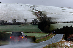 © Licensed to London News Pictures. 10/02/2020. Machynlleth, Powys, Wales, UK. Vehicles drive through a wintry landscape on a road in the Cambrian mountains between Machynlleth and Llanidloes in Powys.  Photo credit: Graham M. Lawrence/LNP