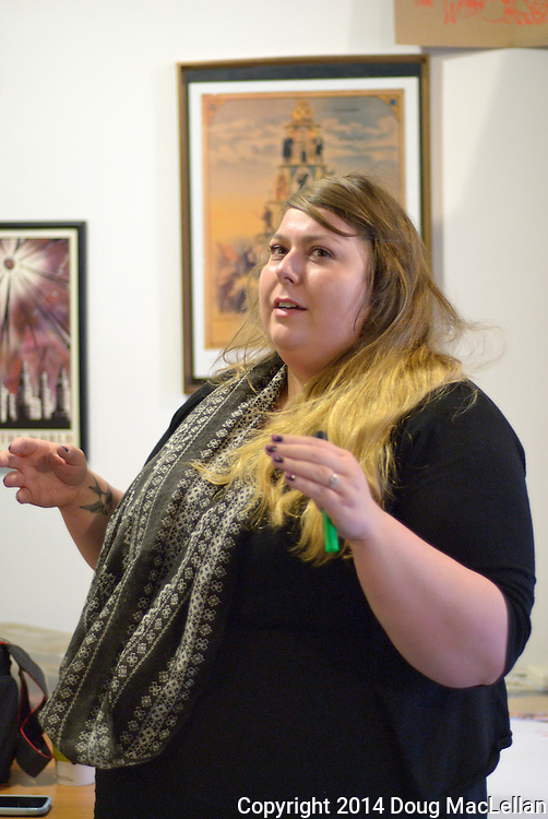 "Nadja Pelkey, Arts Council Windsor& Region, makes a point at the ""Artists and Workers: Community Discussion event at Windsor Workers' Education Centre during MayWorks Windsor 2014."