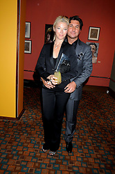 TAMARA BECKWITH and her husband GEORGE VERONI  at a private view of work by Sacha Newley entitled 'Blessed Curse' in association with the Catto Gallery held at the Arts Club, Dover Street, London W1 on 2nd July 2008.<br />