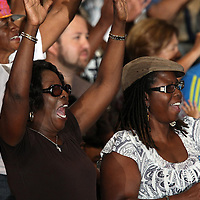 Voters cheer as President Barack Obama takes the stage during his Grassroots event at the Kissimmee Civic Center in Kissimmee, Florida on Saturday, September 8, 2012. (AP Photo/Alex Menendez)