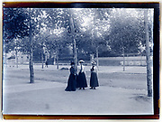 young adult women together in a suburban street  possible Paris early 1920s