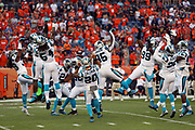 The Carolina Panthers leap and celebrate before the 2016 NFL week 1 regular season football game against the Denver Broncos on Thursday, Sept. 8, 2016 in Denver. The Broncos won the game 21-20. (©Paul Anthony Spinelli)