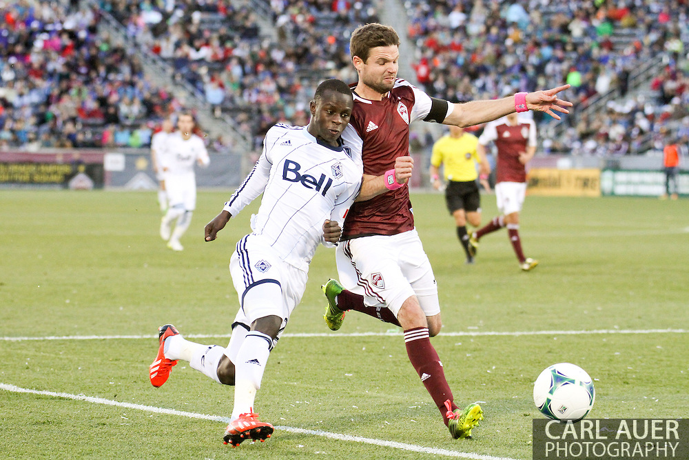 October 19th, 2013:  Vancouver Whitecaps FC forward/midfielder Kekuta Manneh (23) and Colorado Rapids defender Drew Moor (3) push and shove each other as they chase down the ball in the second half of the MLS Soccer Match between the Vancouver Whitecaps FC and the Colorado Rapids at Dick's Sporting Goods Park in Commerce City, Colorado