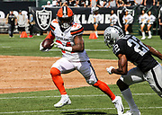 Sep 30, 2018; Oakland, CA, USA;  Brown running back Carlos Hyde (34) eludes Raider cornerback Rashaan Melvin (22) in a game between the Oakland Raiders and the Cleveland Browns. The Raiders defeated the Browns 45-42 in overtime. Mandatory Credit: Spencer Allen-Image of Sport