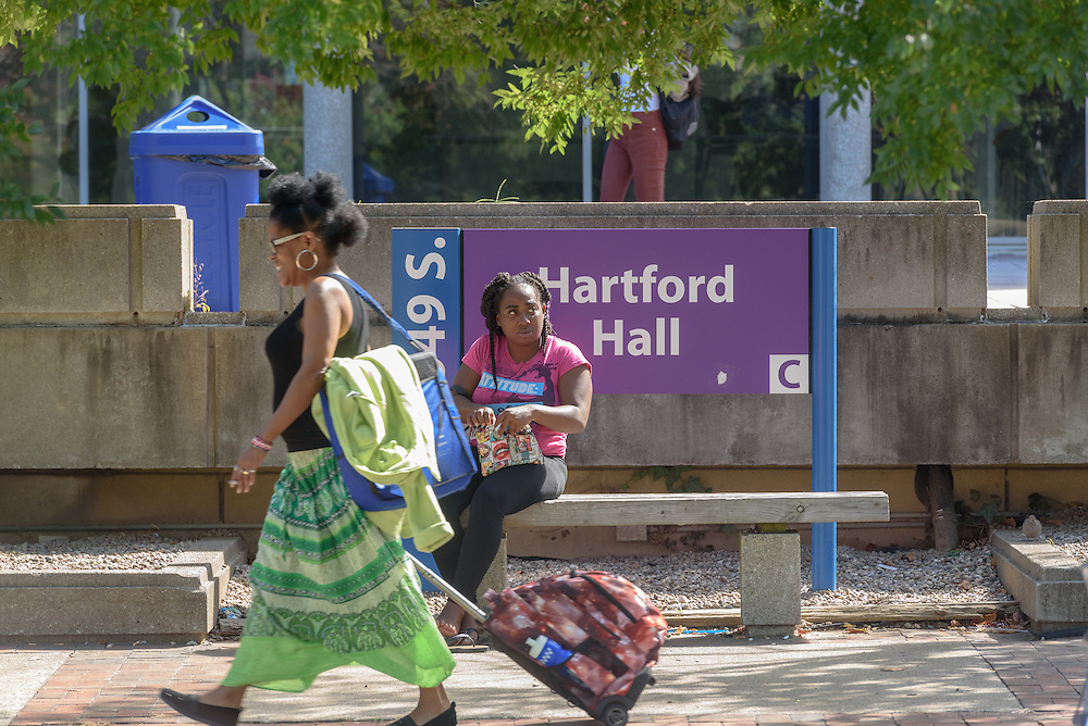 Katrice Gill, left, a communications major/ social justice minor, rests on a bench outside Hartford Hall on First Street on the Jefferson Community & Technical College downtown campus Thursday, Sept. 22, 2016 in Louisville, Ky. (Photo by Brian Bohannon)