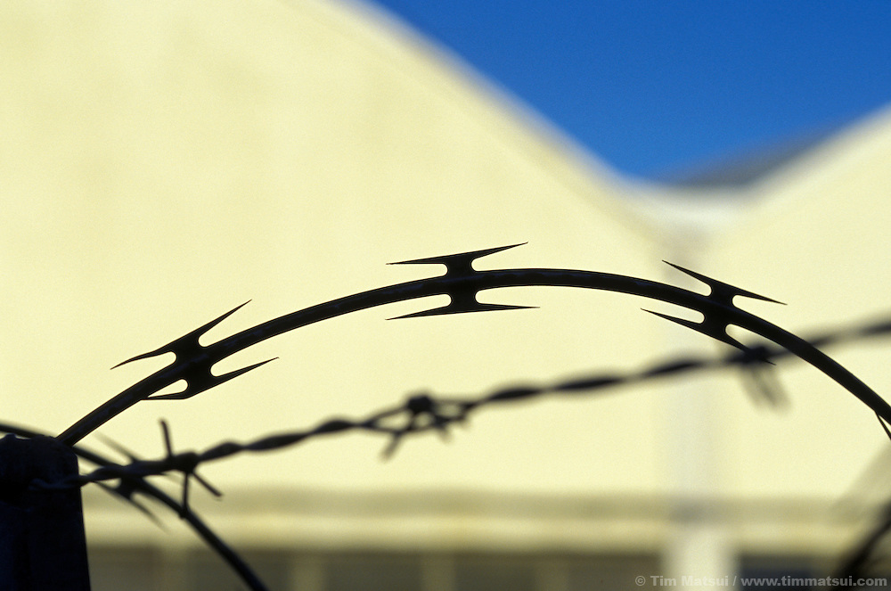 Barbed wire to keep people out and secure the grounds.