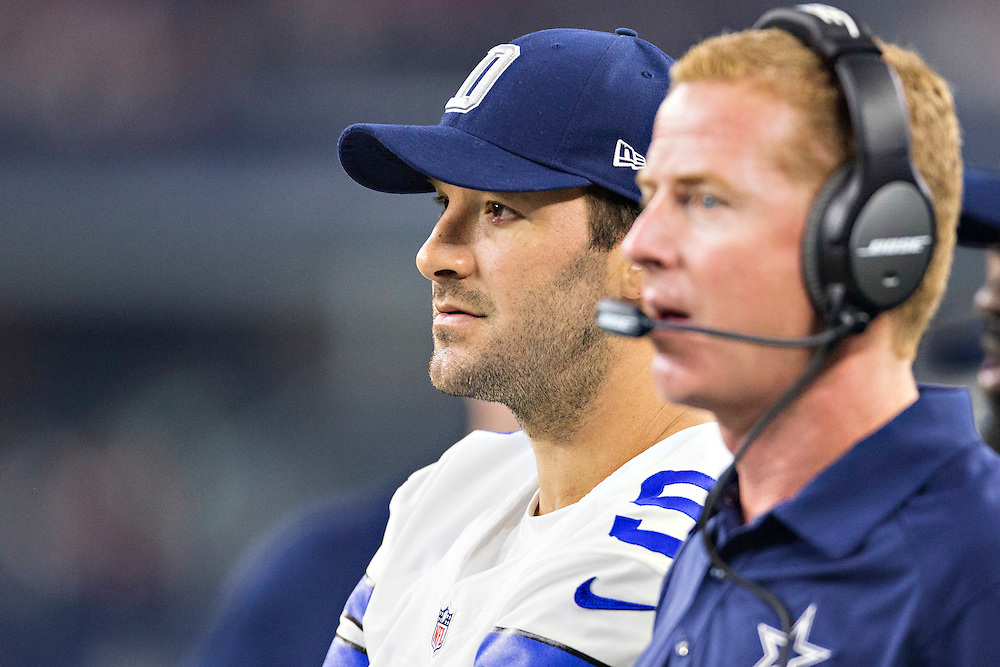 ARLINGTON, TX - SEPTEMBER 3:  Head Coach Jason Garrett and Tony Romo #9 of the Dallas Cowboys on the sidelines during a preseason game against the Houston Texans at AT&T Stadium on September 3, 2015 in Arlington, Texas.  The Cowboys defeated the Texans 21-14.  (Photo by Wesley Hitt/Getty Images) *** Local Caption *** Jason Garrett; Tony Romo
