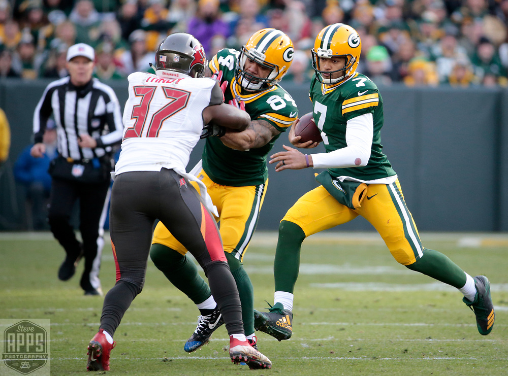 Green Bay Packers quarterback Brett Hundley (7) scrambles for 14-yards behind the blocking of Green Bay Packers tight end Lance Kendricks (84) in the 4th quarter. <br /> The Green Bay Packers hosted the Tampa Bay Buccaneers at Lambeau Field in Green Bay,  Sunday, Dec. 3, 2017. The Packers won in 26-20 in Overtime.   STEVE APPS FOR THE STATE JOURNAL.