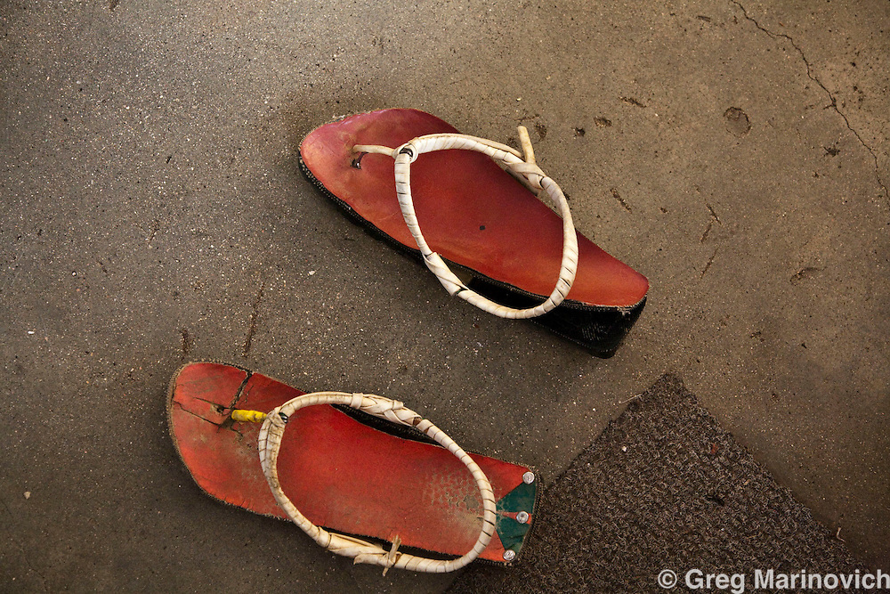 Tradiutional Zulu shoes in the Inkatha Freedom Party stronghold of Madala hostel, origianlly built to house migrant workers under Apartheid was one of the flashpoints in the 90's Hostel War that preceded democratic elections. tiny impoverished township of Alexandra in Johannesburg is alongside Sandton, the ultra wealthy business hub of South Africa. Photo Greg Marinovich