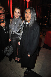 Left to right, ?, Actress NOOMI RAPACE and YOHJI YAMAMOTO at a private view to celebrate the opening of the V&A's exhibition of Yohji Yamamoto fashion designs held on 10th March 2011.