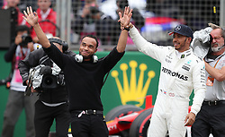 Mercedes Lewis Hamilton celebrates his pole position with his brother Nic during qualifying for the 2017 British Grand Prix at Silverstone Circuit, Towcester.
