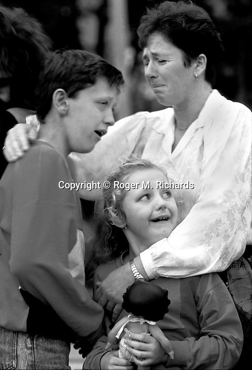 Distraught family members weep as a Red Cross bus with refugees from Sarajevo and other parts of Bosnia departs for exile in western Europe, Zagreb, Croatia 1992. An estimated 200,000 people died during the Bosnian war, and over 10,000 people in total were killed in Sarajevo during the 3-1/2 year siege. (Photo by Roger Richards)