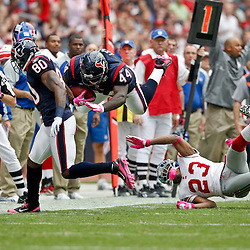 October 10, 2010; Houston, TX USA; New York Giants running back Ahmad Bradshaw (44) is upended on a play by New York Giants cornerback Corey Webster (23) during the first half at Reliant Stadium. Mandatory Credit: Derick E. Hingle