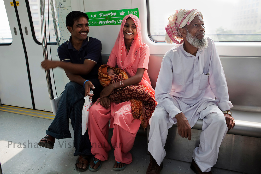 """Raheez Ahmad, 67 travels inside a metro train for the first time using the """"Yellow Line"""" route of the Delhi Metro network in New Delhi, India, on Friday, October 22, 2010. Photographer: Prashanth Vishwanathan/HELSINGIN SANOMAT"""