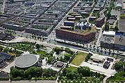 Nederland, Amsterdam, Westerpark, 25-05-2010. Industrieel erfgoed: het voormalige terrein gemeentelijke drinkwaterleidingbedrijf, met watertoren, nu een milieuvriendelijke en autovrije woonwijk, het GWL-terrein. Onder in beeld de voormalige Westergasfabriek, met de voormalige gashouder en daarnaast - de vijvers - de fundamenten van de vroegere andere gashouders..De voormalige fabrieksgebouwen hebben een culturele bestemming gekregen, het terrein wordt gebruikt voor manifestaties, tentoonstelling, expositie, cultuur, industrieel en cultureel erfgoed: cultuurpark. Linksboven de Staatsliedenbuurt..Industrial heritage: the former site of the municipal drinking water company, now a car-free and environmentally friendly residential area. Below the former Western gasworks, with the former gasometer  next ot the ponds (foundations of the other former gasometrs)..The former industrial buildings have a cultural destination, the site is used for events, exhibitions, cultural manifestations: culture park..luchtfoto (toeslag), aerial photo (additional fee required).foto/photo Siebe Swart
