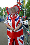 A woman dressed in a Union Jack dress who camped out overnight outside Buckingham Palace to secure the best viewing positions for the two-day Golden Jubilee celebrations to mark the 50 year reign of Queen Elizabeth II. Celebrations took place across the United Kingdom with the centrepiece a parade and fireworks at Buckingham Palace, the Queen's London residency. Queen Elizabeth ascended to the British throne in 1952 upon the death of her father, King George VI.