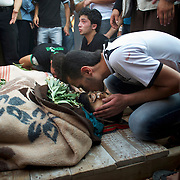 August 09, 2012 - Marea, Aleppo, Syria: Local men mourn the death of Housin Al Ali and Omam Kassam, two Free Syria Army fighters killed in combat in Alepo's Salehedine neighborhood...The Syrian army and the FSA have in the past week exchanged heavy fire in a battle for the control of Syria's economic capital, Aleppo.